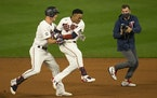 Max Kepler (26) chased down Jorge Polanco to celebrate Tuesday night's walkoff win.
