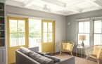 The left-hand wall of this sitting room is painted with Benjamin Moore's Gray Owl OC-52; the right wall is done with Metropolitan AF-690; the ceilin