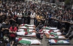 Palestinians attend a funeral on Saturday in Gaza City for two women and eight children who were killed after an Israeli airstrike.
