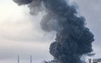 Smoke rises from a building in Gaza City on May 18 after an Israeli airstrike.