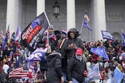 Supporters of then-President Donald Trump storm the Capitol and halt a joint session of the 117th Congress on Wednesday, Jan. 6, 2021, in Washington,
