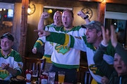 A group of Russian American Wild fans reacted to a Wild goal in the second period during a playoff game between the Wild and the Vegas Knights at Cowb