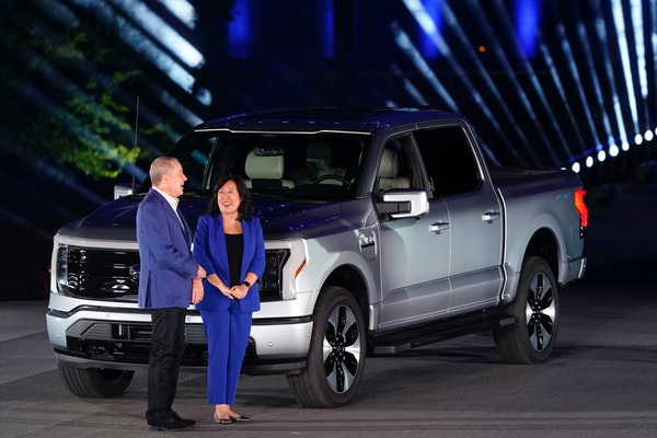 Bill Ford, executive chairman of Ford Motor Company, and Chief Executive Engineer Linda Zhang stand next to the Ford F-150 Lightning at a rollout even
