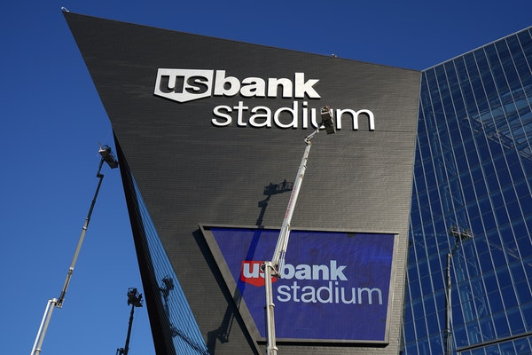 A lift ferried workers to the roof of U.S. Bank Stadium as they made repairs to the building's exterior in December 2020.
