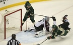 Mikael Granlund's diving goal in overtime gave the Wild a 1-0 victory over Colorado in Game 3 of the 2014 first-round series at Xcel Energy Center.