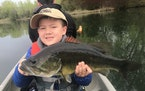 Joshua Nguyen, a 6-year-old from Apple Valley, caught this 5-pound, 20-inch largemouth bass while fishing with his father on an undisclosed lake in th