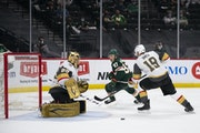 Vegas goaltender Marc-Andre Fleury kicked out a shot by Wild left wing Kirill Kaprizov