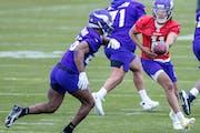 Quarterback Kellen Mond, right, at the Vikings' rookie minicamp last week.