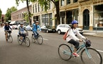 On bikes provided by Cycle Portland, cyclists enjoy an easy-paced tour of historic Old Town while pedaling the Eastbank Esplanade though the Green Par
