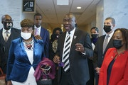 Civil rights attorney Ben Crump, who represented the George Floyd family, is joined by family members of victims of racial injustice following a meeti