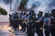 Minneapolis police confront protesters outside the Third Police Precinct after the killing of George Floyd in May 2020. RICHARD TSONG-TAATARII • ric