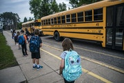 Children arrived for classes at Forest View Elementary in the summer of 2020.