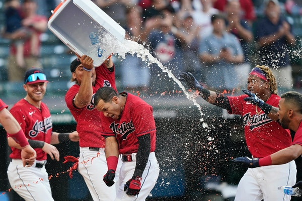 Cleveland teammates douse Cesar Hernandez, center, after he hit the winning two-run home run in the 10th inning against the Twins