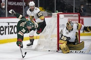 Wild wing Mats Zuccarello tried to keep control of the puck as he came out from behind the net and Golden Knights goaltender Marc-Andre Fleury trailed
