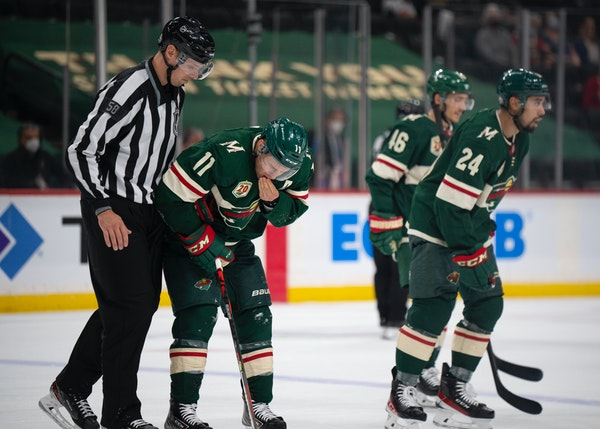 Wild left wing Zach Parise left the ice after being cut by Vegas defenseman Zach Whitecloud in the second period.