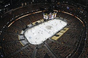 Relaxed COVID-19 restrictions at Vegas' T-Mobile Arena allowed more than 11,000 to attend Game 5 between the Golden Knights and the Wild on Monday n