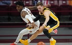 Iowa guard Jordan Bohannon, right, was recovering Monday after sustaining a serious head injury while being assaulted, the university's athletic dep