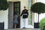 A Marine held the door as Gianna Floyd, the daughter of George Floyd, walked into the White House on Tuesday.