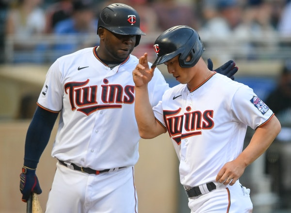 Rob Refsnyder (right) had two doubles and a home  run in Tuesday's game; Miguel Sano struck out four times.