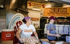 On the Minnesota State Fairgrounds on Wednesday, Alexana Lofton, left, and Megan Hare (right) got the bacon ready for the big weekend.
