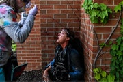 Los Angeles Times photographer Carolyn Cole is shown moments after she was pepper sprayed by Minnesota State Patrol troopers, according to a lawsuit f
