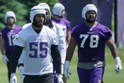 Anthony Barr, left, and Dakota Dozier wear soft-shell helmets designed to reduce the impact of collisions during workouts.
