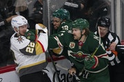 Marcus Foligno (17) connected with a right to the jaw of Vegas Golden Knights defenseman Nick Holden (22) in the third period. Jordan Greenway looked