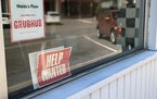 """A """"Help Wanted"""" sign sits in a window of a downtown St. Cloud pizza restaurant."""