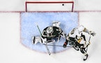 A Vegas Golden Knights shot made it past Minnesota Wild goaltender Cam Talbot (33), but the goal was waved off due to goaltender interference.