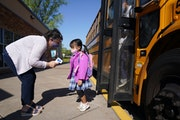 Principal Anne Gattman took students' temperatures as they arrived at St. Jerome School in Maplewood.