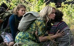 """Left to right, Regan (Millicent Simmonds), Evelyn (Emily Blunt) and Marcus (Noah Jupe) brave the unknown in """"A Quiet Place: Part II."""""""
