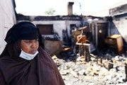 Kaltuma Hassan, owner of Bismillah Grocery & Coffee shop, is shown in a photo taken a few weeks after the establishment was burned in the riots on Lak
