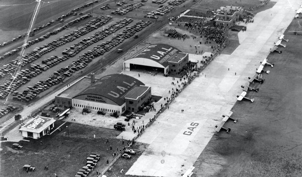 Crowds gathered at Wold-Chamberlain Field in September 1930 for the arrival of famous French pilots. The welcome coincided with a dedication of the ai
