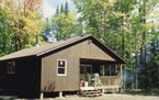 The cabin began with a land purchase, old railroad land for sale in Itasca County.