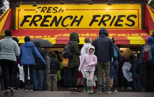 Arlie Gonsior, 6, jumped up and down to stay warm while waiting for fresh french fries with her family Thursday at the Kickoff to Summer at the Fair.