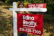In September, Susan Dusek, a Realtor for Edina Realty, posed for a portrait in front of a house for sale in the Congdon Park neighborhood in Duluth.