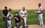 Third base umpire Joe West, center, tosses St. Louis Cardinals manager Mike Shildt (8) after pitcher Giovanny Gallegos was asked to change gloves.