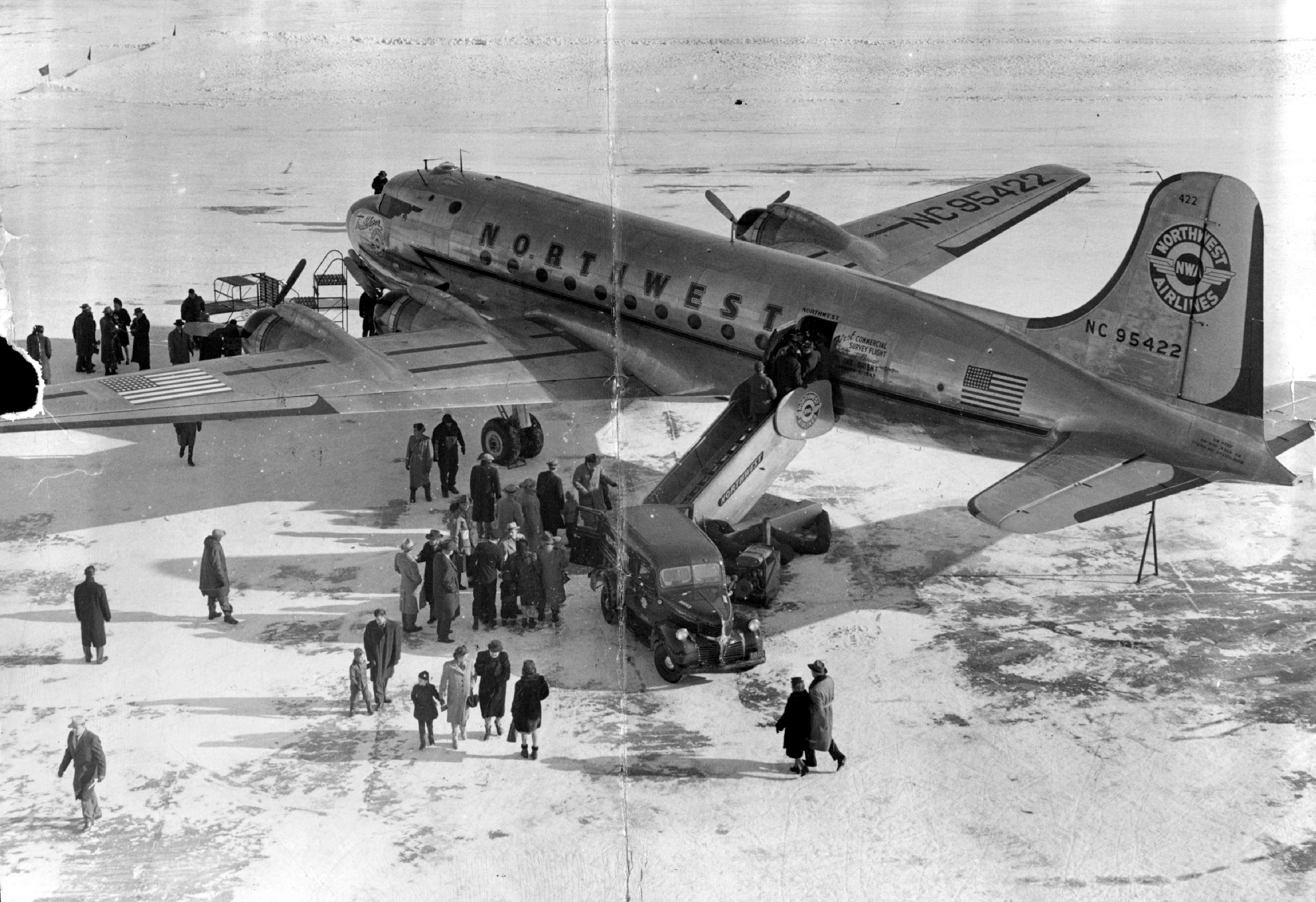 People prepare to board 'Trail Blazer,' a Douglas DC4 airplane, on Jan. 1, 1947. The flight to several countries in Asia was a survey of Northwest Airline's soon-to-be-established overseas route.