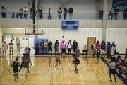Spectators lined the court at Bloomington Jefferson during the Minnesota Showcase basketball tournament last weekend. Soon, NCAA coaches will be among