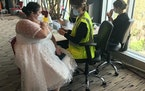 Sarah Studley, 39, at her first coronavirus vaccination appointment at the M&T Bank Stadium vaccination site on April 11, wearing her unused wedding r