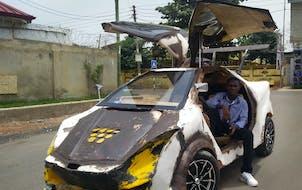 Kelvin Odartei Cruickshank, 19, tools around his hometown of Accra, Ghana, in what looks like a ramshackle DeLorean. It took three years to build. The