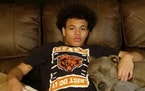 Caleb Livingston with his dogs, Ciroc and Rocko, before he was shot in the head in May 2019.