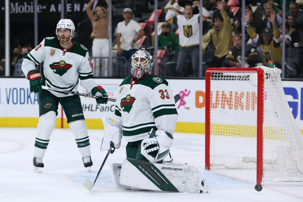 Minnesota Wild goalie Cam Talbot (33) and defenseman Ian Cole (28) react after the Vegas Golden Knights scored during the second period of Game 7