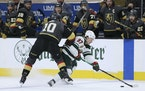 Wild left wing Kirill Kaprizov vies for the puck against Golden Knights center Nicolas Roy during the second period of Game 7