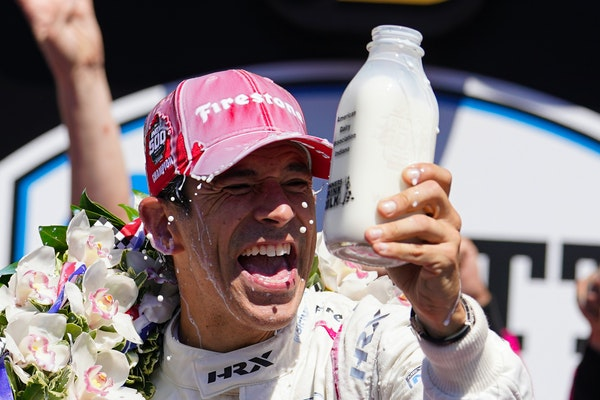 Helio Castroneves of Brazil celebrated after winning the Indianapolis 500 on Sunday.