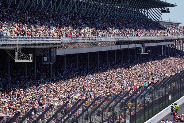 Fans fill the stands during the Indianapolis 500 auto race at Indianapolis Motor Speedway in Indianapolis, Sunday, May 30, 2021. About 135,000 spectat