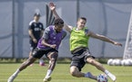 Minnesota United FC defender Jukka Raitala, right, and midfielder Justin McMaster battled for the ball during a recent practice at the National Sports