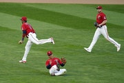 Twins center fielder Rob Refsnyder, center, made a catch between second baseman Jorge Polanco, left, and right fielder Kyle Garlick against the Royals