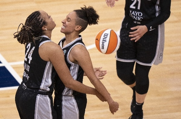 Lynx guard Layshia Clarendon, left, and forward Napheesa Collier celebrate the team's first victory of the season after beating Connecticut 79-74 in