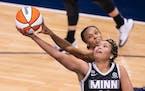 Minnesota Lynx forward Napheesa Collier (24) was fouled by Connecticut Sun forward/guard DeWanna Bonner (24) in the second quarter.
